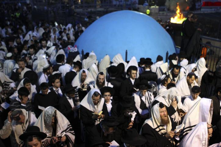 Ultra-Orthodox men celebrate Lag BaOmer at Mount Meron (photo credit: Abir Sultan/Flash90)