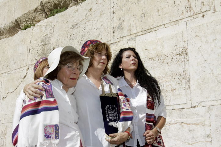 Women of the Wall, with Hoffman at center, posing for Rubinger at the southern section of the Wall on Wednesday (photo credit: Oren Nahshon/Flash90)