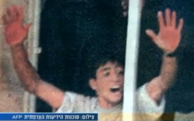 Aziz Salha waving his bloody hands after the lynch of 2 IDF reservists in Ramallah in 2000 (photo credit: screen capture, YouTube)