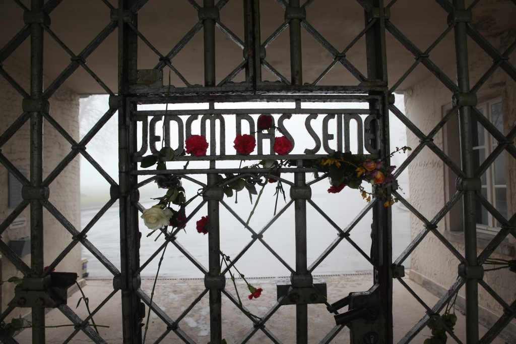 The front gate at Buchenwald whose inscription reads, 'To Each What He Deserves.' (Photo credit: courtesy of Paul Paul Pugliese)