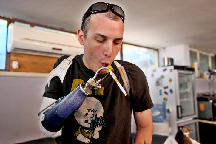 An injured soldier uses medicinal cannabis (photo credit: Abir Sultan/Flash90)