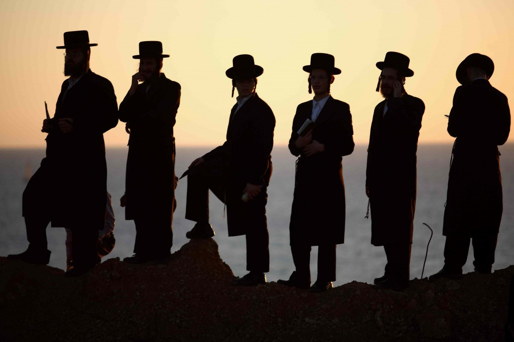"Israel prepares for a day of reflection. Ultra-Orthodox men complete the Tashlich (""forgiveness"") ceremony at the Mediterranean Sea on Monday (photo credit: Yehoshua Yosef/FLASH90)"