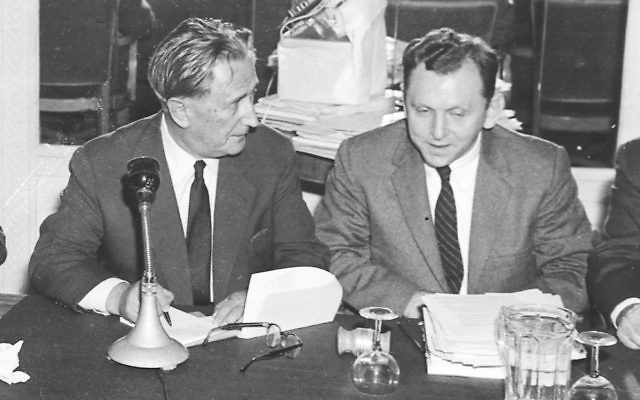 Saul Kagan, the founding executive director of the Claims Conference, right, speaks with Nahum Goldmann, the founder and longtime president of the World Jewish Congress, in 1958. (Courtesy Claims Conference via JTA)