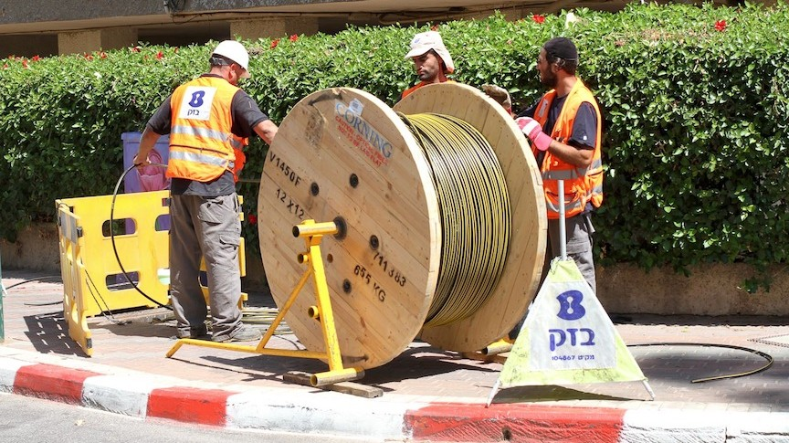 Bezeq workers installing fiber optic cables (Photo credit: Courtesy)
