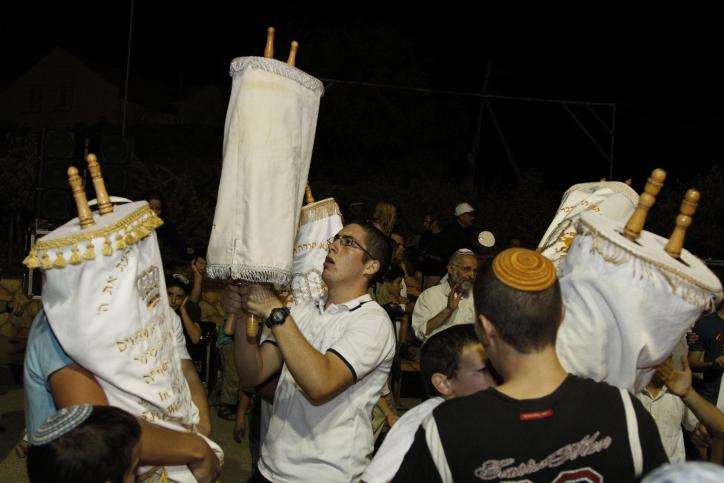 Israelis dance with Torah scrolls during the festival of Simchat Torah, September 2010. (photo credit: Gershon Elinson/Flash90)