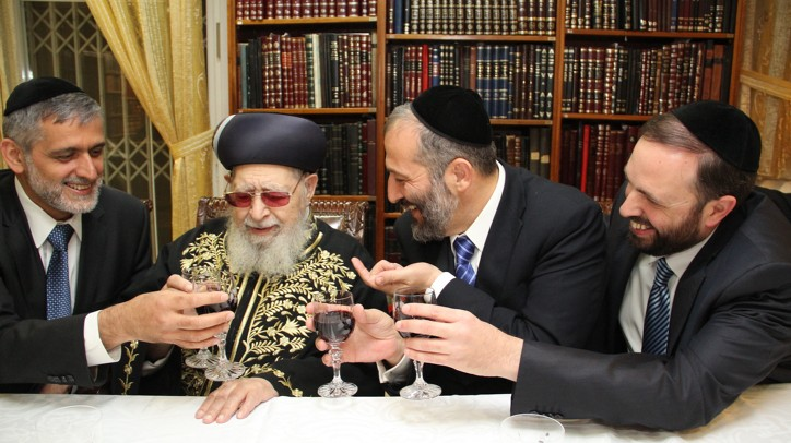 Rabbi Ovadia Yosef (center) flanked on the left by Interior Minister Eli Yishai, and on the right by former party chairman Aryeh Deri and Minister of Housing Ariel Attias, at the Rabbi's house in Jerusalem, in October (photo credit: Shas/Flash90)