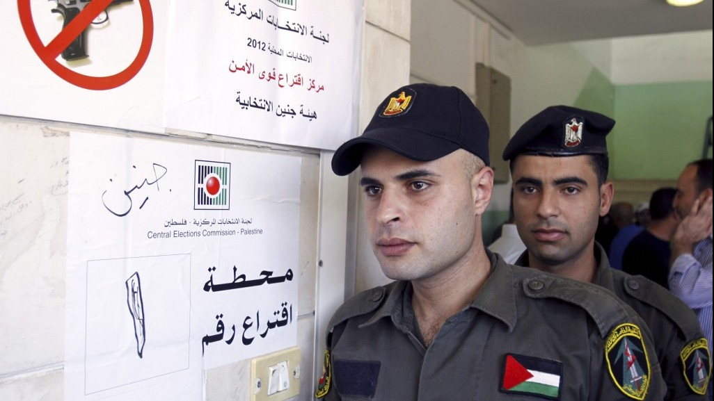Palestinian security officers wait to cast their early votes during local elections at a polling station in the West Bank town of Jenin on Thursday. Members of Palestinian security forces cast an early vote ahead of local elections, which are taking place Saturday, in the first such polls since 2006.(photo credit: AP Photo/Mohammed Ballas)