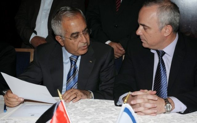 Finance Minister Yuval Steinitz (right) meets with PA Prime Minister Salam Fayyad as they sign an economic agreement in Jerusalem on July 31 (photo credit: Moshe Milner/GPO/Flash90)