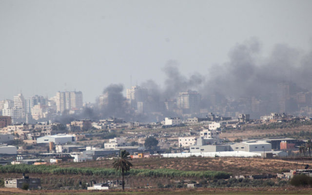 Smoke rises from a building in the northern Gaza Strip after an Israeli airstrike on November 16 (photo credit: Uri Lenz/Flash90)