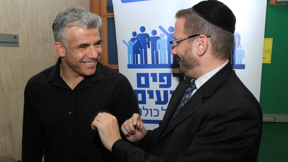 US-born Rabbi Dov Lipman, right, and Yesh Atid chairman Yair Lapid (photo credit: Yaakov Lederman)