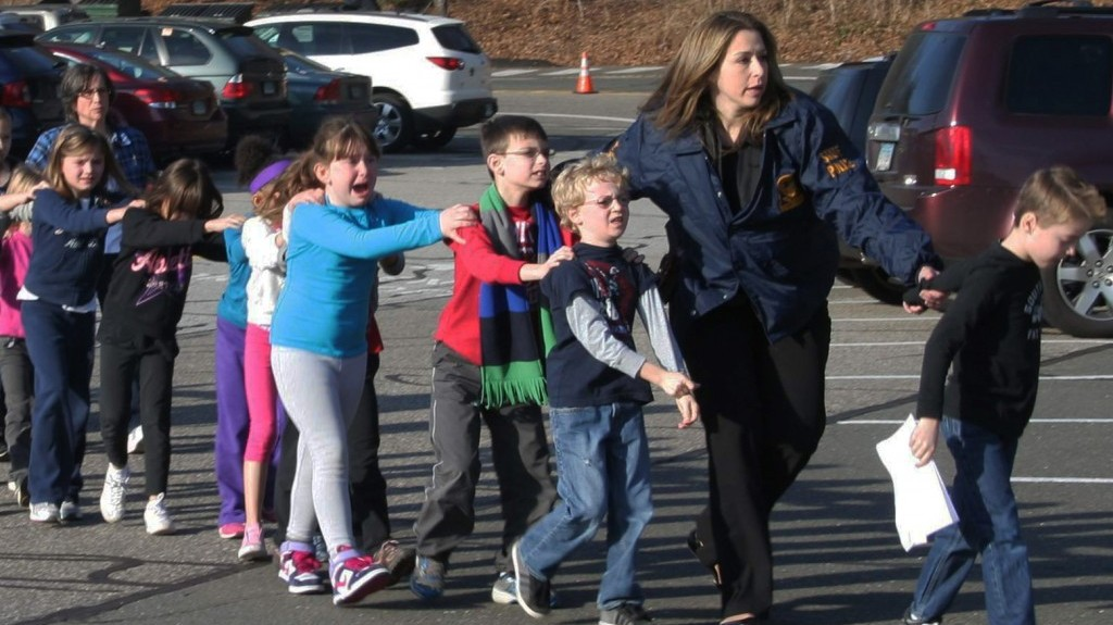 In this photo provided by the Newtown Bee, Connecticut State Police lead a line of children from the Sandy Hook Elementary School in Newtown, Conn. on Friday, Dec. 14, 2012 after a shooting at the school. (photo credit: AP Photo/Newtown Bee, Shannon Hicks)