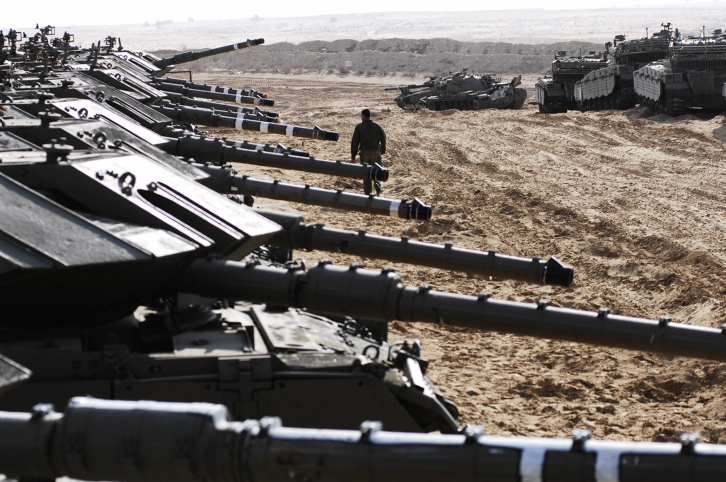 Israeli tanks at the staging ground outside Gaza on December 29, 2008, the third day of Operation Cast Lead (Photo credit: IDF Spokesperson/ Flash 90)
