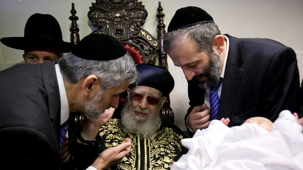 From left: Eli Yishai, Rabbi Ovadia Yosef and Aryeh Deri, the leaders of the ultra-Orthodox Shas party attend a circumcision on election day morning (photo credit: Yonatan Sindel/Flash90)