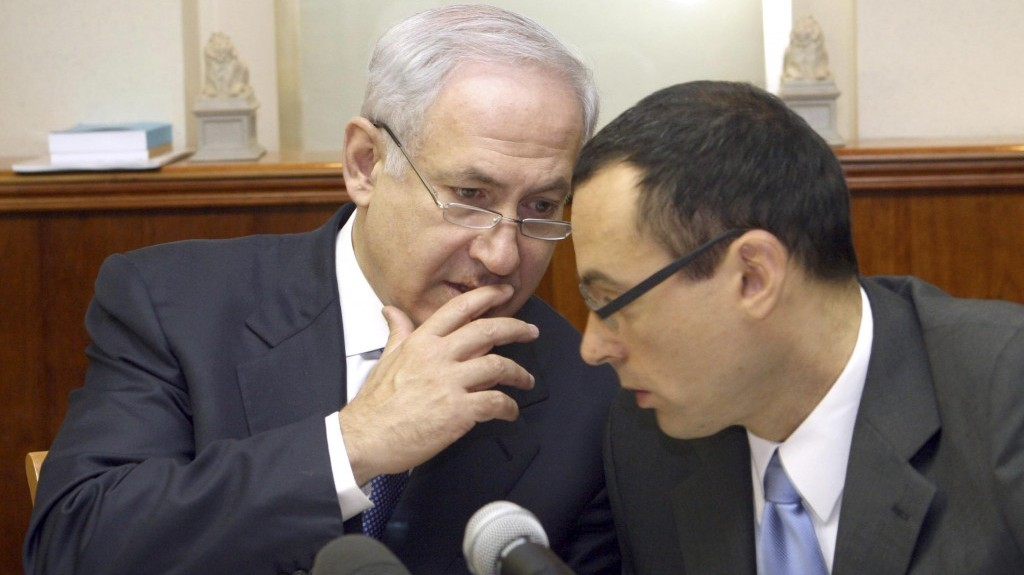 Prime Minister Benjamin Netanyahu, left, speaks with Cabinet Secretary Zvi Hauser at a weekly cabinet meeting in July 2009. (photo credit: Ariel Jerozolimski/Flash90/File)