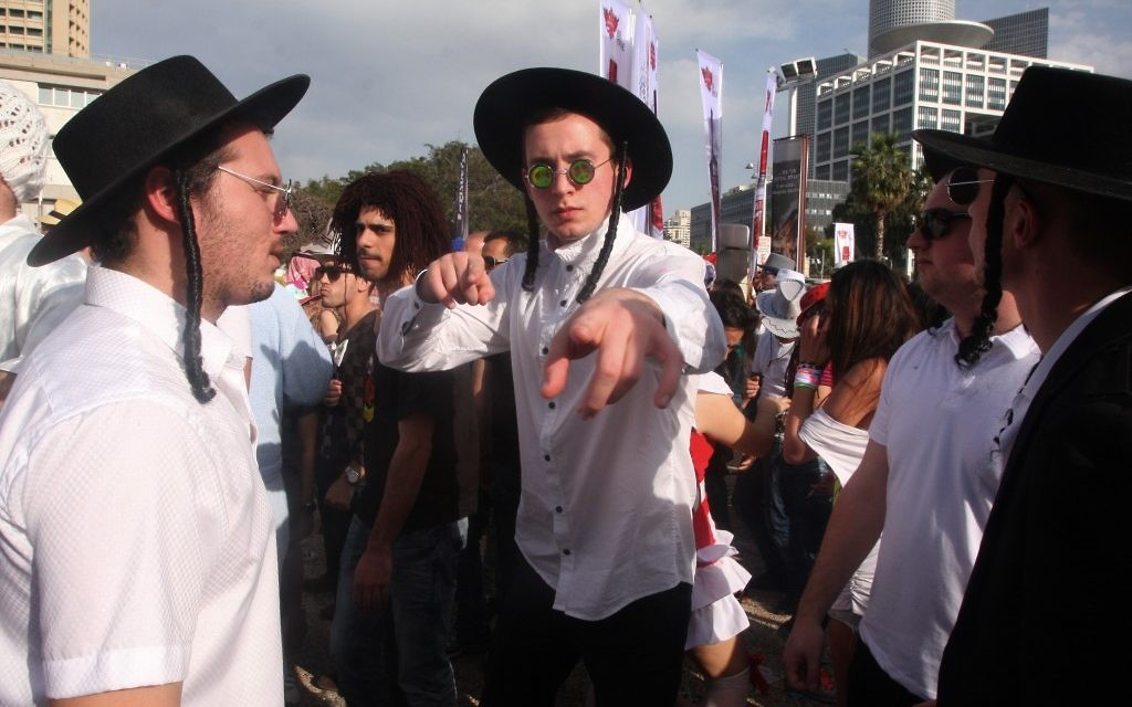 It's all about masks and masquerades; fake 'haredim' in Tel Aviv on Purim (photo credit: Roni Schutzer/Flash 90)