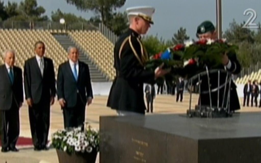 President Barack Obama, flanked by Prime Minister Netanyahu and President Shimon Peres, at the grave of Theodor Herzl on Mt. Herzl, March 22 (photo credit: Channel 2 screenshot)