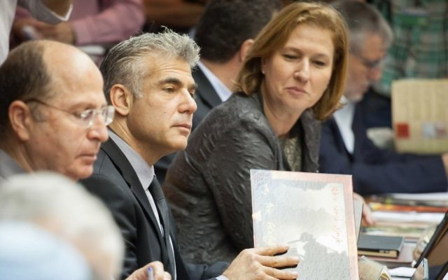 Yair Lapid (center), and Tzipi Livni (right) at a Cabinet meeting in May 2013. (photo credit: Emil Salman/Pool/Flash90)