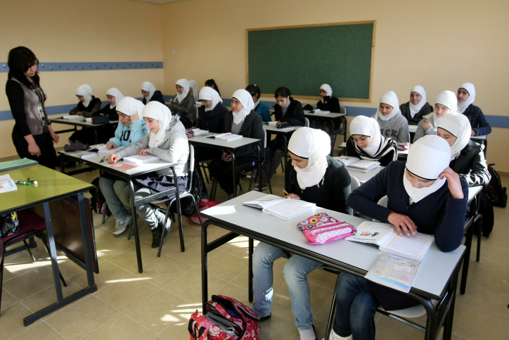 (Illustrative) Young Arab girls seen studying during a lesson in an elementary school, December 13, 2011. (photo credit: Kobi Gideon/FLASH90)