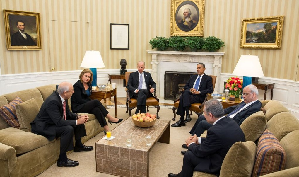 President Barack Obama and Vice President Joe Biden, along with Palestinian Chief Negotiator Saeb Erekat and Mohammed Shtayyeh (right) and  Israeli Justice Minister Tzipi Livni and Yitzhak Molho (left) at the formal resumption of direct Israeli-Palestinian negotiations, in the Oval Office, July 30, 2013 (photo credit: Official White House Photo, Chuck Kennedy)