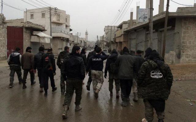 Des combattants de la brigade Ahrar Al-Sham qui appartient au front islamique, le 27 janvier 2014 à Alep (Crédit: Alep media center/AFP/Archives Baraa al-Halabi)