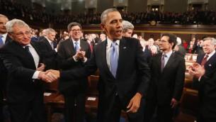 Le président américain Barack Obama est applaudi après son discours sur l'état de l'Union, le 28 janvier 2014 au Capitole, à Washington  (Crédit : Pool/AFP Larry Downing)
