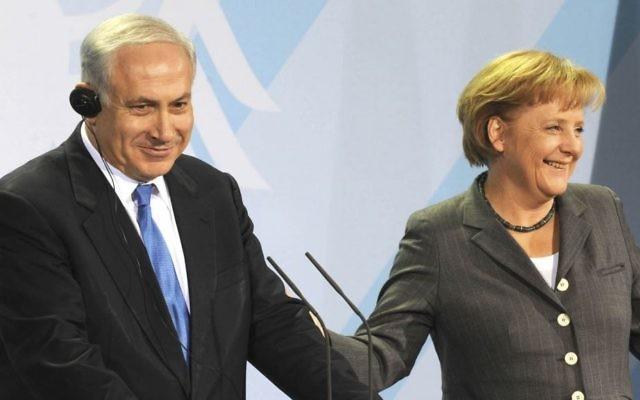 Le Premier ministre Benjamin Netanyahu et la chancelière allemande Angela Merkel (Crédit : Moshe Milner/GPO/Flash90)