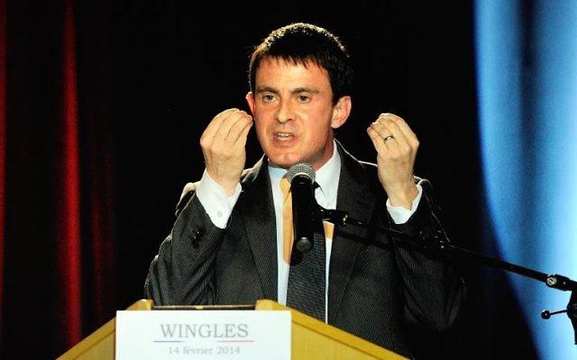 Le ministre de l'Intérieur Manuel Valls à Wingles le 14 février 2014 (Crédit : AFP/Archives Philippe Huguen)