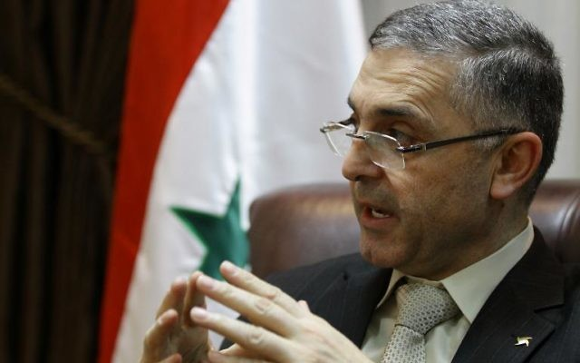 Le ministre syrien de la Réconciliation nationale, Ali Haidar, à Damas le 11 février 2014 (Crédit : AFP/Louai Beshara)