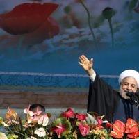 Le président iranien Hassan Rouhani à Téhéran, le 11 février 2014. (Crédit : AFP/Atta Kenare)