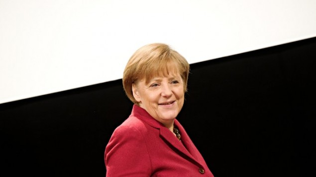 La Chancelière allemande Angela Merkel arrive à une conférence de presse, le 14 mars 2014 (Credit : AFP PHOTO/DPA/NICOLAS ARMER/GERMANY OUT)