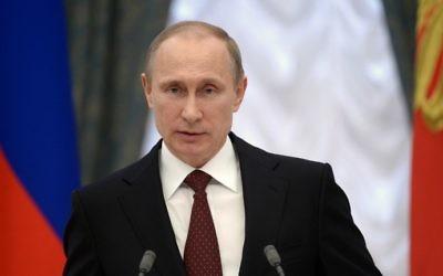 Le président russe Vladimir Poutine prononce un discours lors d'une cérémonie au Kremlin, le 25 mars 2014 (Crédit : Alexei Nikolsky/AFP Photo/Ria Novosti/POOL)