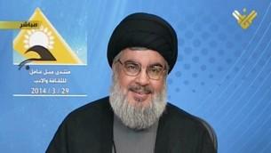 Le chef du Hezbollah lors de son discours télévisé sur la chaîne du Hebollah Al-Manar, le 29 mars 2014 (Crédit : AFP Photo/Al-Manar)