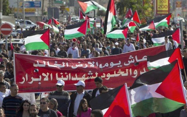 """Des Arabes Israéliens et des Palestiniens célèbrent la """"Journée de la Terre"""" (Crédit Ahmed Garhabli/AFP)"""