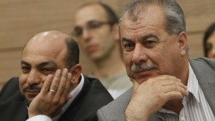 Le leader du parti Hadash, Mohammad Barakeh (à droite) et le député du parti Ra'am Ta'al Masoud Ganaim en 2012. (Crédit : Miriam Alster/Flash90)