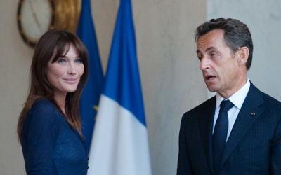Nicolas Sarkozy et son épouse Carla Bruni-Sarkozy (Crédit : Martin Bureau/AFP)