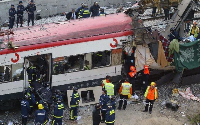 Scène de l'attentat de Madrid du 11 mars 2004 (Crédit  : Pierre Philippe Marcou/AFP)