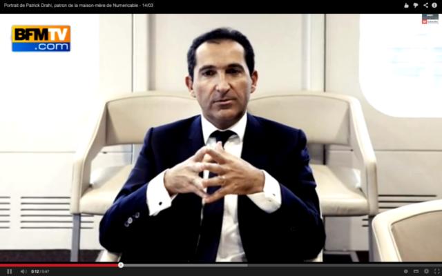 Patrick Drahi, président de la chaîne d'information i24News. (Crédit : capture d'écran YouTube/BFM)