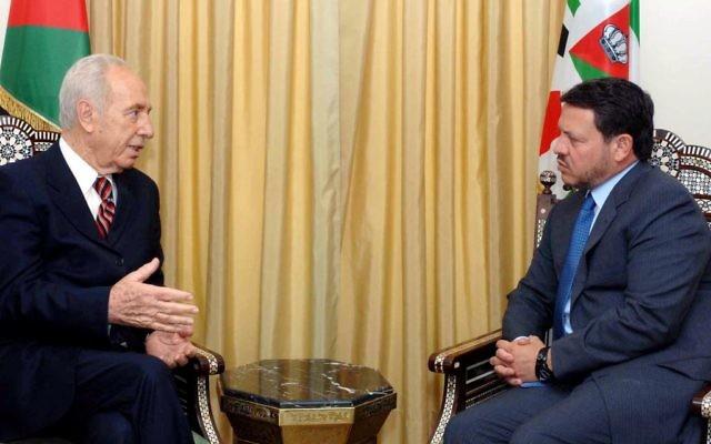 Le président israélien et le roi jordanien Abdullah II, juin 2006 (Crédit : Moshe Milner /GPO /Flash90)