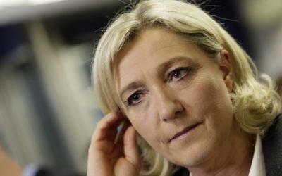 La présidente du parti français d'extrême-droite le Front National, Marine Le Pen, à Nanterre, le 30 mars 2014 (Crédit : Kenzo Tribouillard/AFP)