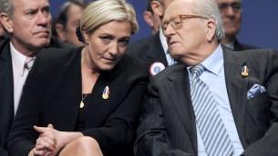 Jean Marie Le Pen et sa fille Marine (Crédit : Miguel Medina/AFP)