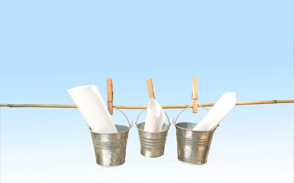 http://www.shutterstock.com/pic-164628755/stock-photo-concept-three-galvanized-buckets-pegged-on-bamboo-stick-with-blue-background.html?src=pp-same_artist-164628665-xNI9eNZRC0j71W4HrTzsKw-1
