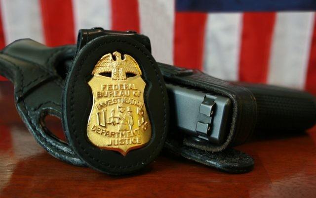 Illustration d'un badge du FBI (Crédit : Autorisation Wikipedia)