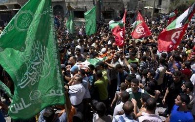 L'enterrement de la femme de Mohammed Deif , le 20 août 2014 (Crédit : AFP Photo/Roberto Schmidt).