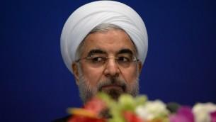 Le president iranien, Hassan Rouhani, à une conférence de presse à Shanghai le 22 mai 2014 (Crédit : AFP/Mark Ralston)