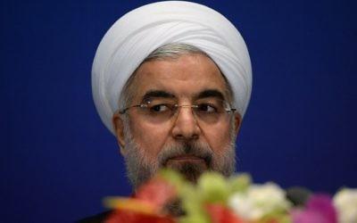 Le président iranien, Hassan Rouhani, pendant une conférence de presse à Shanghai, le 22 mai 2014. (Crédit : AFP/Mark Ralston)