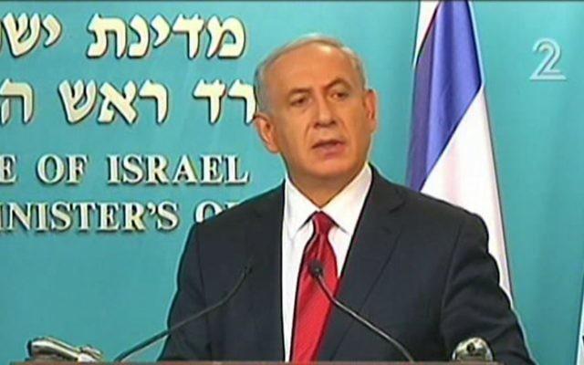 Benjamin Netanyahu s'adresse aux Israéliens après l'attaque terroriste contre la synagogue d'Hart Nof - 18 novembre 2014 (Crédit : capture d'écran Deuxième chaîne)
