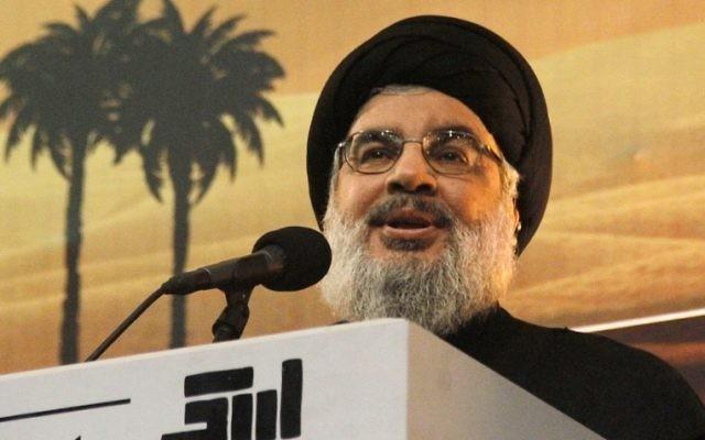 Hassan Nasrallah pendant la procession de l'Achoura à Beyrouth, le 3 novembre 2014. (Crédit : AFP/STR)