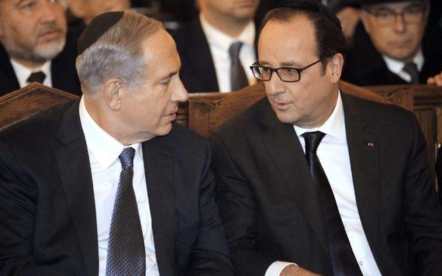 Le président français François Hollande et le Premier ministre Benjamin Netanyahu à la Grande synagogue de Paris, le 11 janvier 2015. (Crédit : MATTHIEU ALEXANDRE / POOL / AFP)