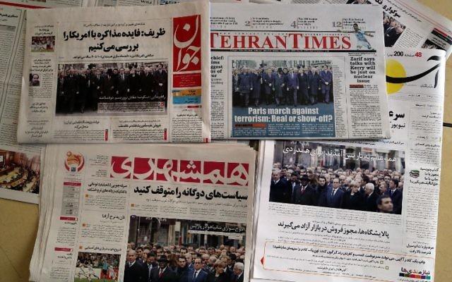 Les Unes des journaux iraniens au lendemain de la publication des récentes caricatures par Charlie Hebdo (Crédit : ATTA KENARE / AFP)