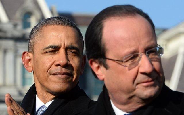 Le président français François Hollande (à droite) et le président américain Barack Obama sur la pelouse de la Maison Blanche, le 11 février 2014. (Crédit :  AFP/Jewel Samad)